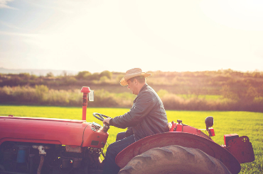 Image of a man driving tractor