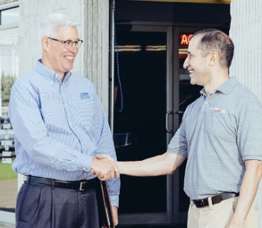 Image of Steve Stiffler shaking hands with a customer
