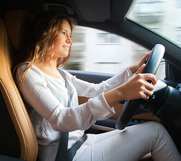 Image of a lady driving a car