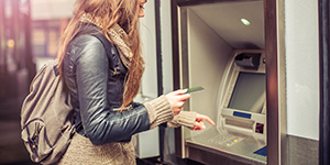 Image of a person at an ATM
