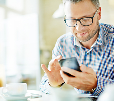 Image of a man texting
