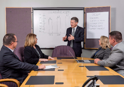 Image of CSB's Senior Management Team in a meeting
